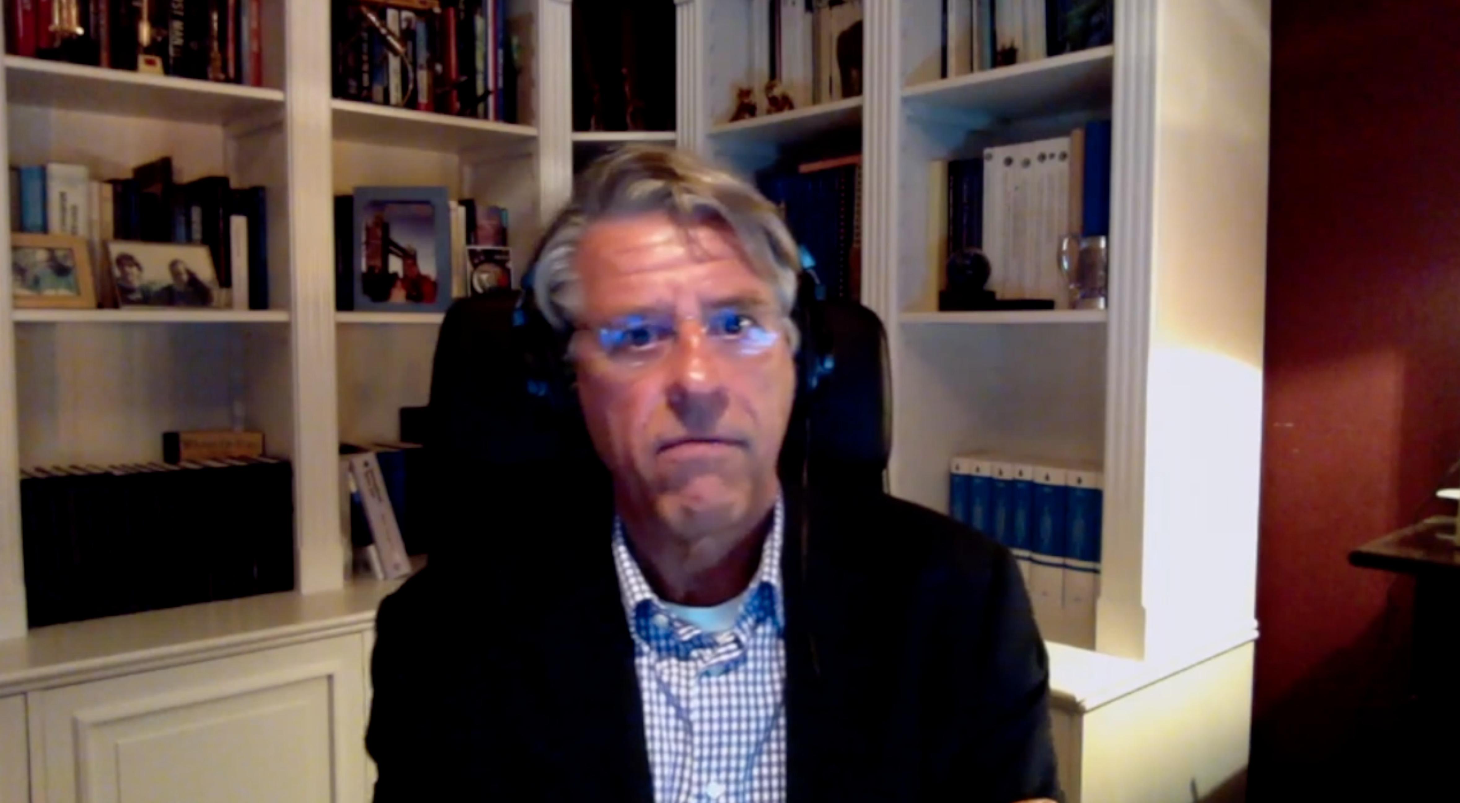 Professor von der Dunk sitting at his desk, shown via web conference.