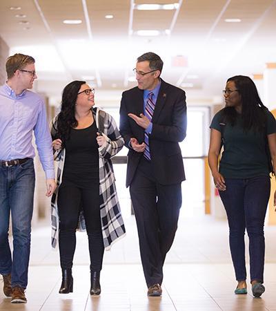 Interim Dean Richard Moberly talks with students